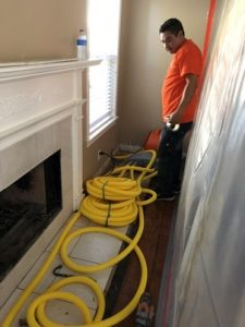 Technician Performing Water Extractions In A Residential Property