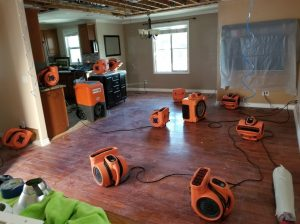 Water Damage Restoration In A Flooded Living Room