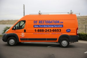 911-restoration-water-damage-mold-remediation-fire-damage-person-van-wideangle